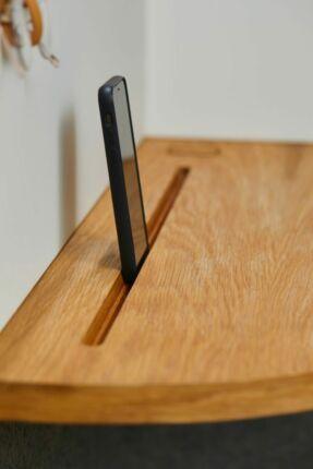 black smartphone on brown shelf