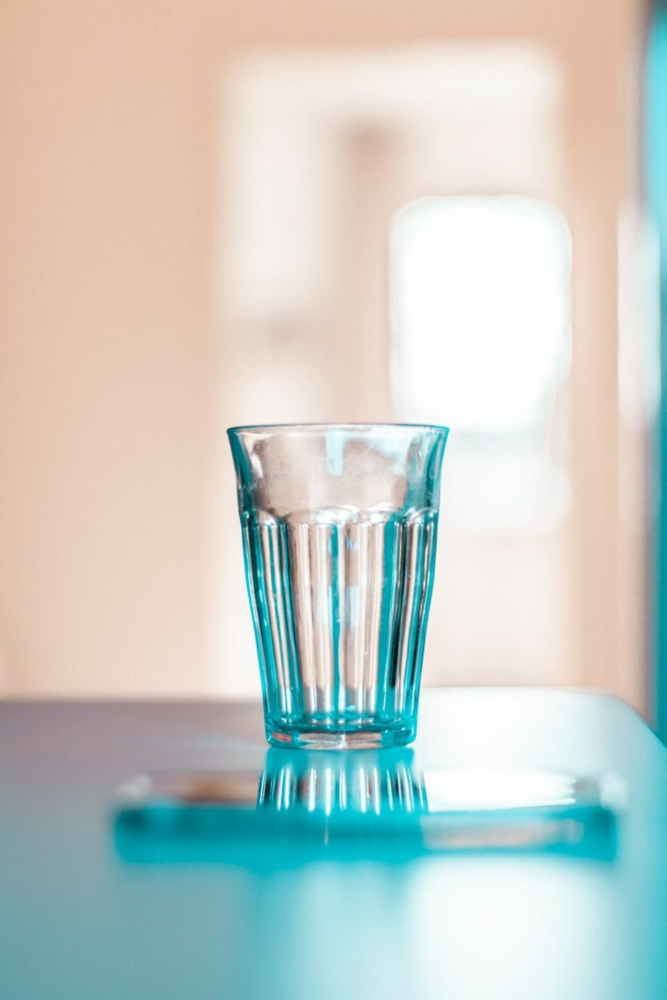 clear drinking glass on white table