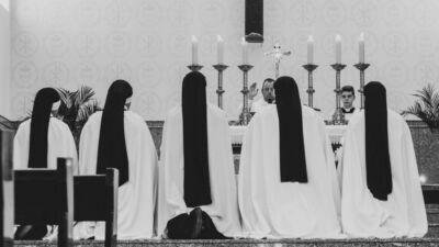 five person in white dresses