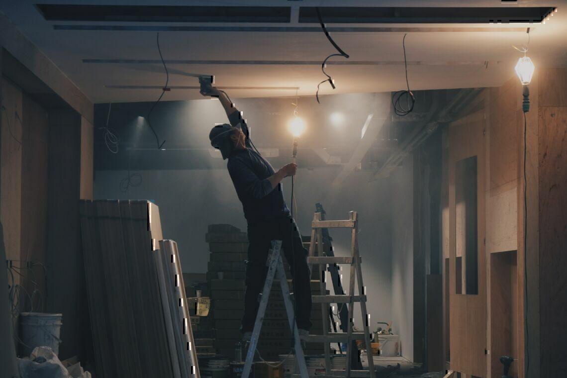 man on white ladder