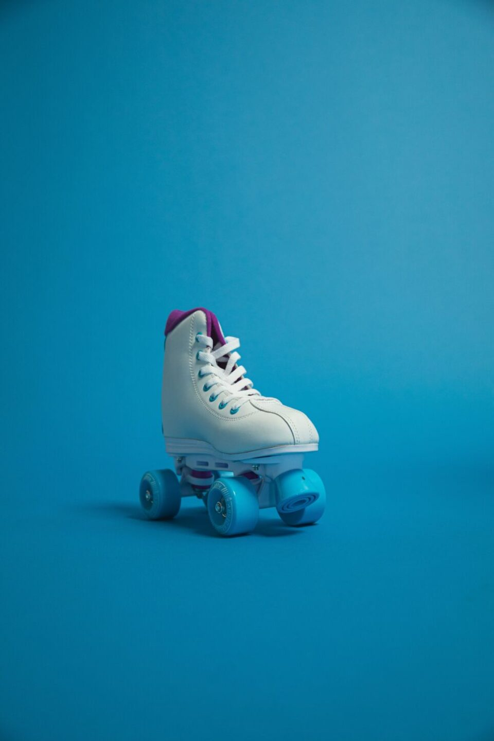 unpaired white and blue roller skate