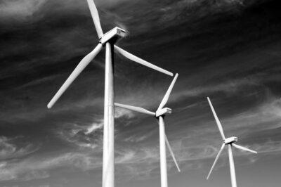 three windmills under clouds