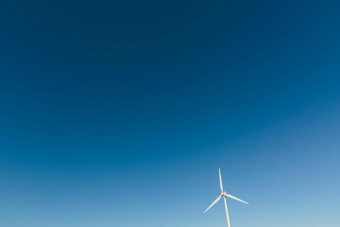 photo of white wind turbine during daytime