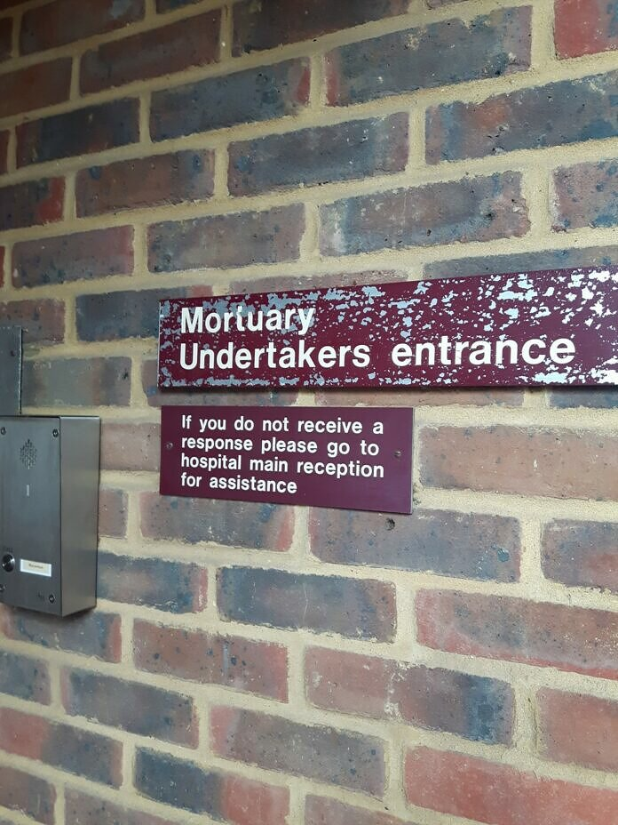 black and white wall mounted signage