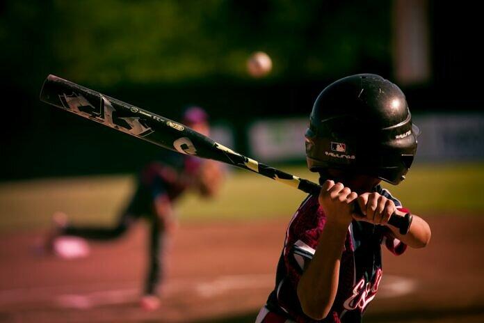 selective focus photography of person holding baseball bat