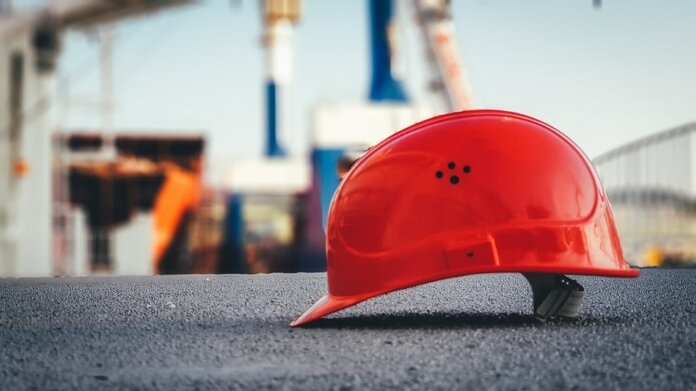 red hard hat on pavement