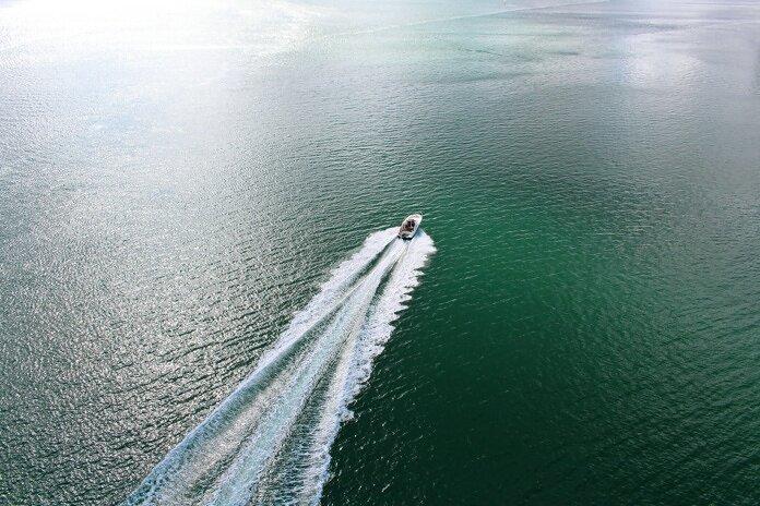speedboat on body of water