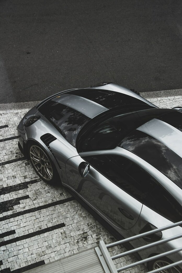 aerial view photography of gray car parked on street