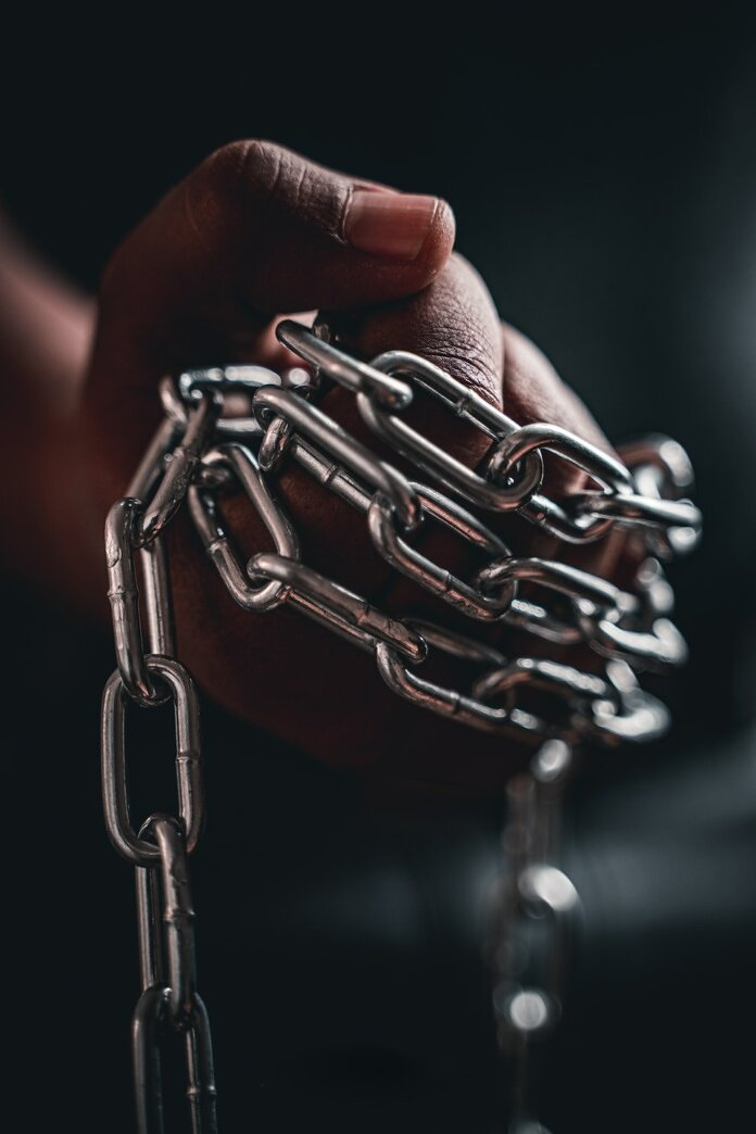 person holding silver chain link