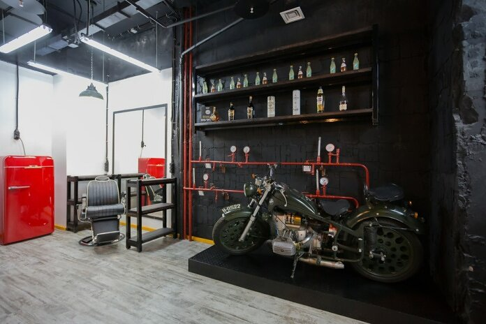 black motorcycle parked beside red truck