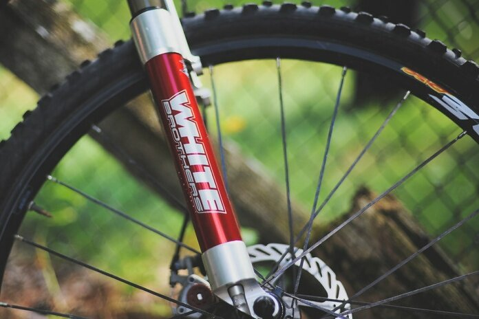 white brothers sticker on red bicycle telescopic