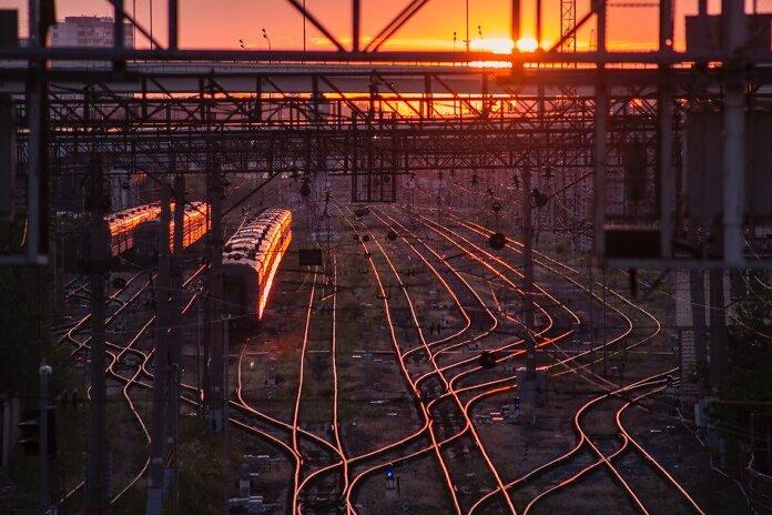 black train on railway during golden hour