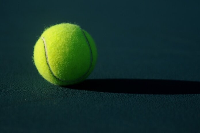 green tennis ball on ground