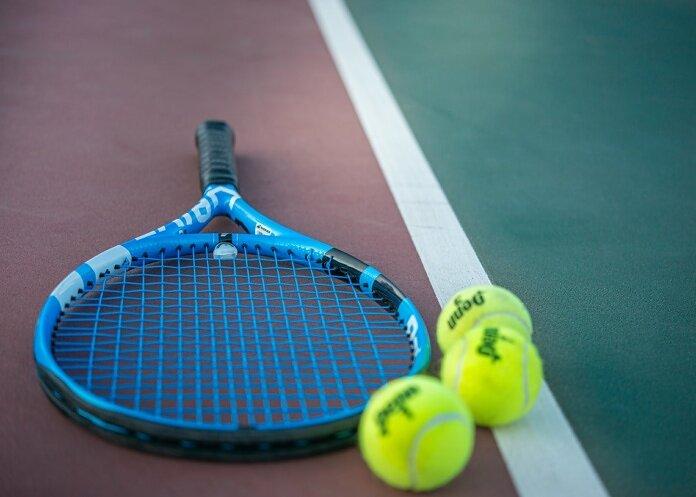 yellow and blue tennis racket
