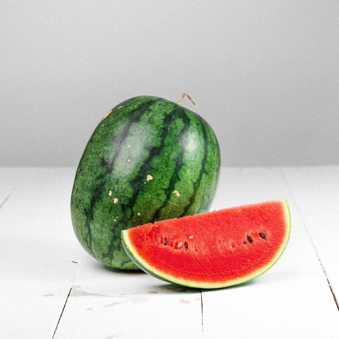 watermelon fruit on white table
