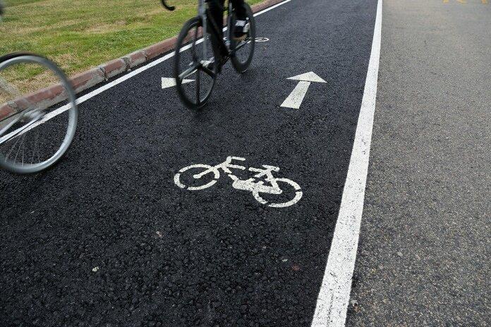 black bicycle on black asphalt road