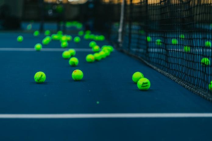 green tennis balls on tennis court