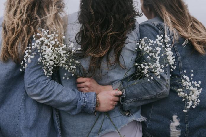 group of women facing backward