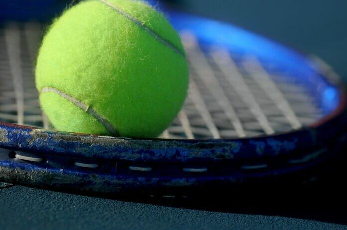 green tennis ball in closeup photography