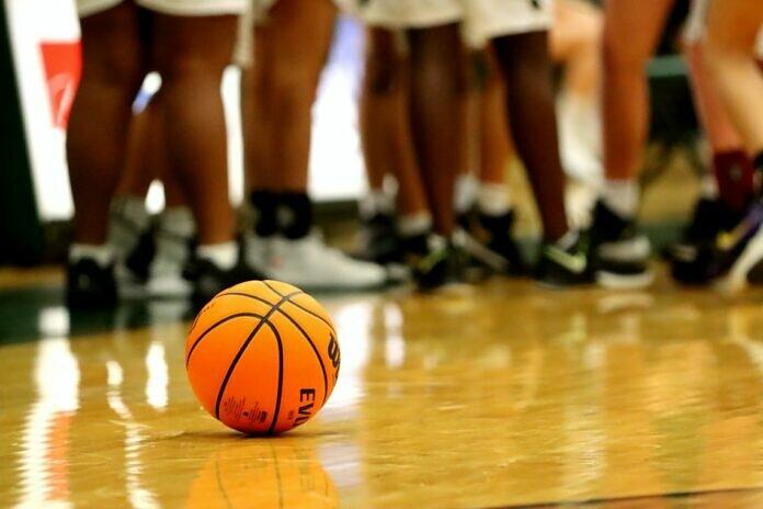 orange basketball on brown wooden floor