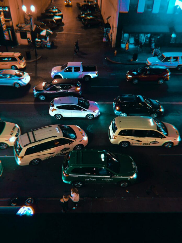 white car park beside store during night time